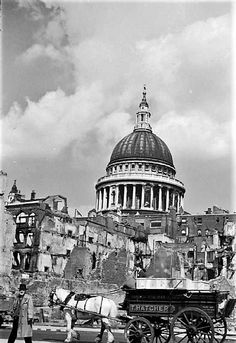 1941 ....a horse & cart carries crates of eggs past the ruined buildings close by St Paul's Cathedral, that were destroyed in the blitz.....