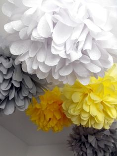 Yellow, gray and white tissue poms from Pom Tree's Etsy site.