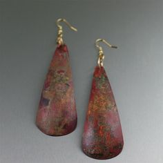 Copper Earrings / Red Patinated Copper Drop Earrings - Romanticize your ensemble with this seductive pair of Red Patinated Copper Drop Earrings. The rich red hues from the patination process and the elegant curved design definitely makes a bold statement that is the perfect complement to your bewitching nature.  $75  http://www.johnsbrana.com/red-patinated-copper-drop-earrings.html