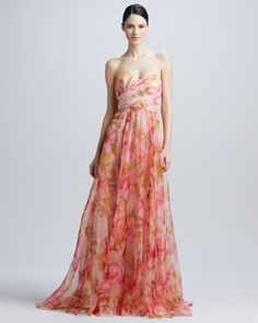 Badgley Mischka Strapless Floral-Print Gown Watercolor floral-print chiffon fits and flows on this beautiful bloom of a gown from the Badgley Mischka Collection.  Floral-print chiffon over satin.  Sweetheart neckline with open back.  Sleeveless.  Fitted with ruching and wrapped chiffon to waist.  Full A-line skirt; back zip.  Silk.  Imported.  Neiman Marcus $990