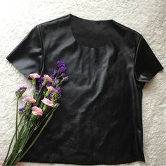 {american apparel} vegan leather shirt NWOT NWOT Super cool and casual piece.      • no offsite transactions • negotiations only through offer tool • new? sign up with code BJHWY for $10 off! American Apparel Tops