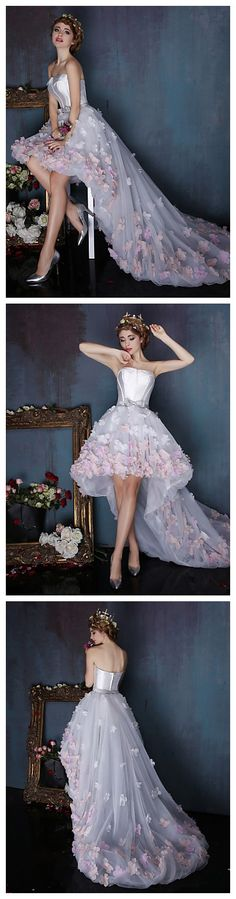 Amazing gorgeous wedding dress with flower faucets on! Looking for a fairy like winter wedding dress style? Take a look at this!
