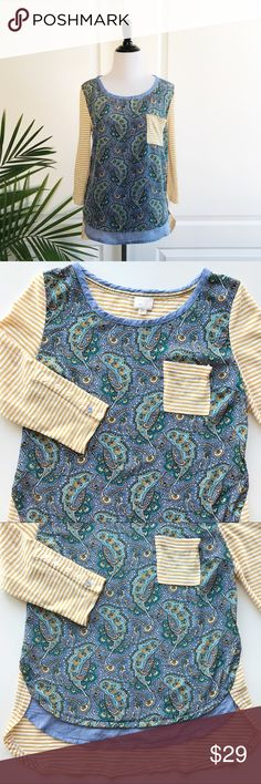 "Anthropologie Postmark Paisley Striped Top Anthropologie Postmark Paisley Striped Top *Size Small - Underarm to underarm : 18"" / Length: 24-27"" *3/4 sleeve / Round neckline / Single front pocket / Paisley Printed front / Striped back / chambray neck trim and a layer *57% cotton and 43% polyester - Machine wash *In great pre-loved condition with mild signs of wear - There's very tiny hole on the back near right arm. Please check out the last photo. *No trade G Anthropologie Tops Tees - Long…"