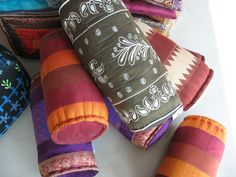 Bolster cushions- various colours- limited qtys. Bolster Cushions, Ottomans, Sunglasses Case, Colours