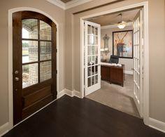 Large stained wood door | Benders Landing Estates - Plan F762