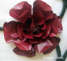 Metal flowers - tutorial on the website, make them out of soda cans.  Very pretty!
