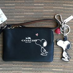 Coach Snoopy Wristlet Keychain NWT Coach Snoopy Wristlet Keychain NWT~Size 6 X unless Bundled Coach Bags Clutches Wristlets Coach Handbags, Coach Purses, Purses And Handbags, Leather Handbags, Coach Snoopy, Coach Bags Outlet, Fendi, Gucci, Cheap Coach