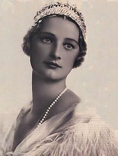 Queen Astrid of Belgium (Stockholm, Sweden November 17 1905- Küssnacht am Rigi, Switserland, August 29 1935), wife of king Leopold III of Belgium and mother of both king Boudewijn and king Albert II, she also had a daughter the grandduchess of Luxembourg Josephine Charlotte. She was a very popular queen known for her charity and died tragicly on holiday with her husband. She was in a car accident and died instantly. She was deeply mourned by both the family and the people
