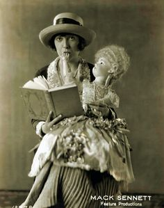 """You don't think I READ the paper, do you? But I do like the dictionary--it looks so well among my other books. They are dummies and the dictionary is the only real thing among them. The cook loves to get the correct spelling of the things she makes."" -- Mabel Normand"