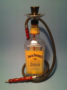 ( Jack Daniels Honey ) One Man Hookah Black w/ 1 Hose This is a Quality Handmade Hookah – Shisha Recycled and Handmade from bottles saved by local restaurants, bars and local area shops. We re-purpose these bottles by taking our time and turning them into great looking Hookahs for you and your friends to enjoy.