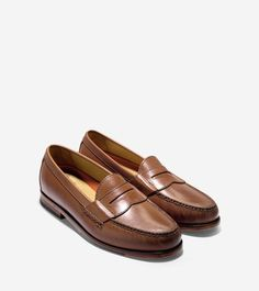COLE HAAN | This handsome shoe features a sleek leather upper with a traditional slot over the foot.