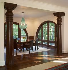 We Complemented The Dramatic Arched Windows In This Queen Anne Style House With Balinese Columns