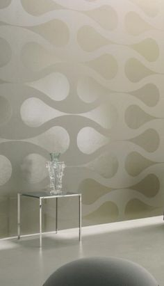 This sleek and chic wallpaper by designer Ulf Moritz plays with the light by alternating matte and shiny surfaces.