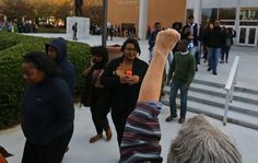 Morehouse College students join others in a rally and march from King's Chapel on their campus to the CNN Center in the wake of the grand jury decision not to indict officer Darren Wilson in the shooting death of Ferguson, MO., teen Michael Brown on Tuesday, Nov. 25, 2014, in Atlanta.