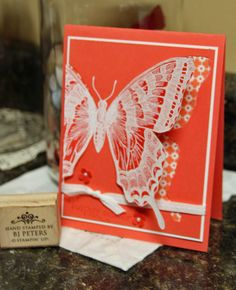 handmade card ... Stampin' Up! ...Swallowtail ... BJ Peters, ...embossed white on coral and colored with same color range ... white accents ... delightful!!
