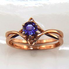 Gold Celtic Wedding Set with Diamond R84  Absolutely gorgeous - I'd just want it as a one-piece ring - none of this wedding ring stuff!...and definitely with this purple stone!