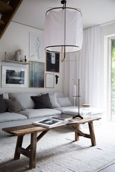 Neutral Scandinavian boho living room of My Scandinavian Home | simply wall gallery | rustic coffee table | light grey linen sofa | IKEA Söderhamn sofa with a Bemz Loose Fit Urban cover in Silver Grey Rosendal Linen