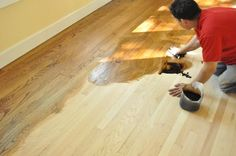 Learn how professional contractors refinish hardwood floors including sanding, edging, buffing, staining and sealing the floor.