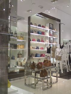 Love this effective handbag Power Wall. It conveys product dominance in an instant!