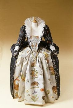 A 2001 recreation by Isabelle de Borchgrave of the 1592 dress that Bess of Shrewsbury (of Hardwick Hall) embroidered for her friend Queen Elizabeth I.  The skirt motifs here have been painted.