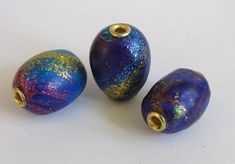 https://flic.kr/p/u4wkxm | faux glass beads | liquid clay, acrylic ink and ultra fine glitter over a solid bead core