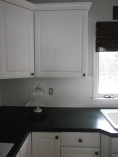 Painting ceramic tile, painting a tile backsplash, painting grout and tiles, kitchen renovations, by Amber B Interios from the Simple Dwellings blog.