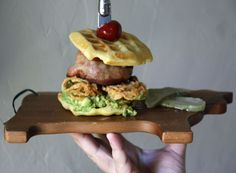 Colossal Burger: bacon wrapped burger, onion rings, guacamole and a cornmeal waffle #sundaysupper