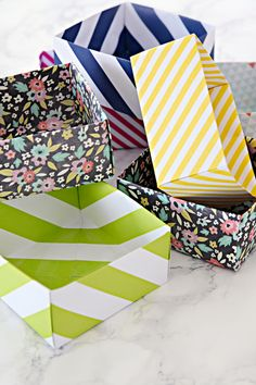 LOVE these DIY Paper Boxes / Drawer Organizers made out of scrapbook paper.  Great tutorial.  Via IHeartOrganizing