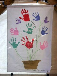 [DAY 1- FAITH] handprint art- make a tree on one side of the children's sukkah and have everyone put their hand as a leaf, writing their names in sharpy