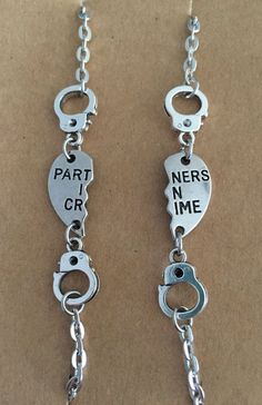This listing is for a 2 bracelet set perfect for partners in crime Each bracelet measures 7 inches but can be altered on request. Please convo me to let me know if you would like any variations