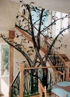 I want this large metal tree in my back garden/patio with tiny white christmas tree lights all over it. Spectacular!