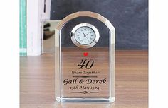Personalised Ruby Wedding Anniversary Crystal This fabulous Personalised Ruby Wedding Anniversary Crystal Clock makes a wonderful keepsake gift to give a very special couple celebrating 40 years of marriage.This Ruby Anniversary Crystal Clock can http://www.comparestoreprices.co.uk/anniversary-gifts/personalised-ruby-wedding-anniversary-crystal.asp