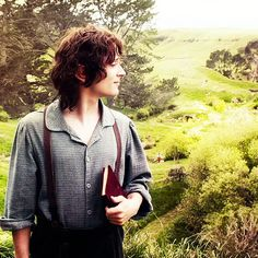 Frodo in the Shire. He has a book. He's only ever read stories and heard the tales Bilbo tells. His head is full of the wonderful things that can happen when wizards appear to hobbits. He has no inkling of what is in store for him. No idea of the horrors he will witness nor the sacrifices that will be asked of him. All he goes forward with, is a heart full of the simple love of the Shire-folk. Nothing will ever be the same.