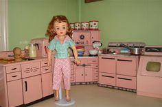 Miss Revlon in her pink kitchen.