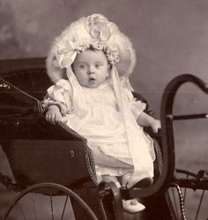Baby with Bonnet and Carriage