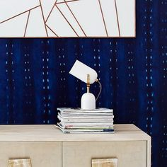 I love this little light from West Elm.  Accent Spotlight Table Lamp