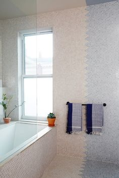 Remodeling your bathroom on a budget? Use this simple tile trick that is low cost, but high style. You can go colorful or monochrome and still get an interesting and unique look.