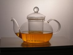 This classic style teapot is made of handblown tempered borosilicate glass. Sprinkle some tea leaves in the glass chamber & add boiling water to the teapot. Your tea leaves will steep inside the handy removable glass infuser. Just gorgeous! #teapot #tea #infuser #glassware #hottea #vegan