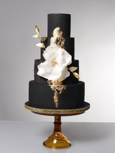black and gold wedding cake with fantasy flower #weddingideas #blackweddingcakes #weddingcake