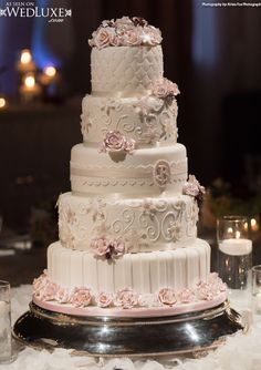 Luxury  blush pink swirls and sugar flowers Wedding Cake