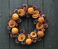 Whole oranges and white pinecones all beautifully arranged on a willow circle for a truly magical festive door wreath.