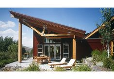 Exterior detail of the terrace.  Contemporary, modern exposed structure  on a mountain style residence.  Wood siding, timbers, and shed roofs.