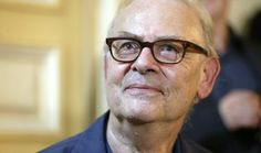 Patrick Modiano, who's typically known for being media-shy, steps into the spotlight for a press conference in Paris following his Nobel win on Thursday.