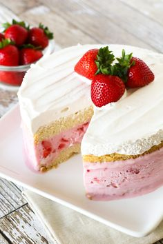 Gluten Free Vegan Strawberry Ice Cream Cake. Layers of vanilla cake, So Delicious Dairy Free strawberry ice cream and creamy Cocowhip. A gorgeous frozen treat!