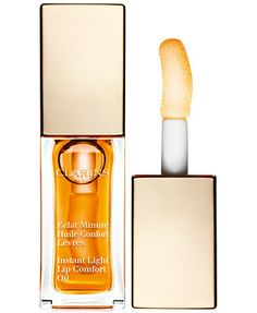 Clarins First-ever Formula!Instant Light Lip Comfort Oil Enhances & Nourishes with 100% pure plant oils.Sheer brilliance. Clarins' newest treatment oil transforms lips from dry and damaged, to plump a