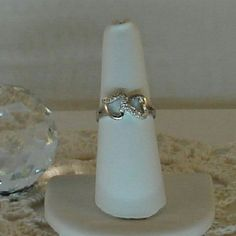 Double Heart Ring with 6 Genuine Diamonds Feminine elegance! This stunning double heart ring is accented with six sparkling  genuine diamonds. This size 7 ring is platinum over solid sterling silver. See gemstone details in this listing. New.  Measurements and weights are approximate. Photos may be enlarged to show detail. Jewelry Rings