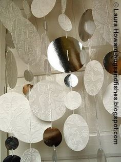 How To: Wallpaper Snowflake Curtain or Mobile  ... (so pretty with the mirror!)  ... http://bugsandfishes.blogspot.com/2011/12/how-to-wallpaper-snowflake-curtain-or.html