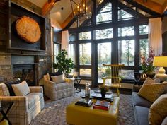 HGTV Dream Home 2014 Lake Tahoe living room 2. A little bit rustic/cabin, colonial chair painted in contemporary color, transitional chairs, contemporary coffee table/ottoman, and insult rial feel not seen in this photo