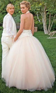 Ellen DeGeneres and Portia de Rossi on their wedding day.  Portia de Rossi wears Zac Posen