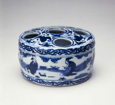 Container for ink sticks, Ming dynasty, Jiajing six-character mark within double-circles and of the period (1522-1566), China, Jingdezhen, Jiangxi province. Porcelain with underglaze blue decoration. H. 3 1/8 in x Diam. 5 1/8 in, H. 7.9 cm x Diam. 14.0 cm. Gift of Roy Leventritt, B69P44L. © 2016 Asian Art Museum Chong-Moon Lee Center for Asian Art and Culture